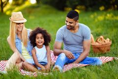 Picture of lovely couple with their daughter having picnic Royalty Free Stock Photo
