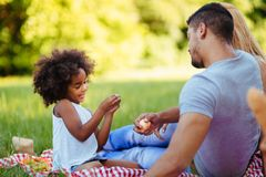 Picture of lovely couple with their daughter having picnic Stock Photography