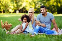 Picture of lovely couple with their daughter having picnic Stock Photo