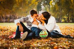 Picture of lovely family in autumn park, young parents with nice adorable kids playing outdoors, five cheerful person have fun on Stock Image