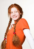 Picture of lovely redhead girl with long braids Stock Photography