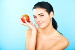 Picture of lovely woman with apple Stock Images
