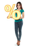 Picture of lovely woman holding percent sign Royalty Free Stock Image