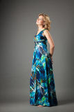 Picture of lovely woman in long dress Stock Images