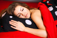 Picture of lovely woman with pillow in bed Stock Photos