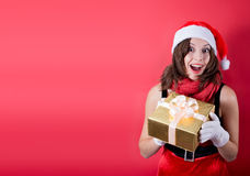 Picture of lovely woman in red dress with present Royalty Free Stock Image