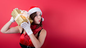 Picture of lovely woman in red dress with present Stock Photo
