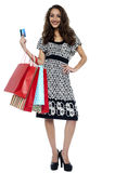 Picture of lovely woman with shopping bags and credit card Stock Photo