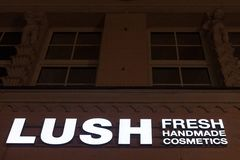 Lush Cosmetics logo on their main store in Munich, Germany. Lush is a brand of beauty products retailers. Picture of the Lush sign on their shop in Munich stock photography