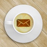 Picture of the mail in the coffee foam Royalty Free Stock Photo