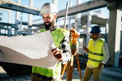 Picture of construction engineer working on building site Royalty Free Stock Photos