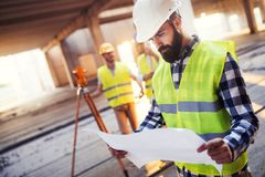 Picture of construction engineer working on building site Stock Photos