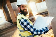 Picture of construction engineer working on building site Royalty Free Stock Image