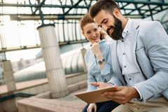 Picture of man and beautiful woman as business partners. Picture of handsome men and beautiful women as business partners Royalty Free Stock Images