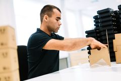 Picture of man boxing products for dispatching stock image