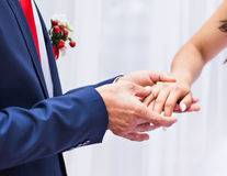 Picture of man putting  wedding ring on woman hand Stock Photography