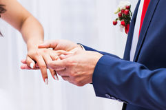 Picture of man putting  wedding ring on woman hand Stock Photos