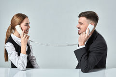 Picture of man and woman with telephone at the table Stock Photos