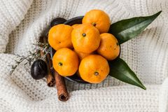 Mandarins With Leaves, Cinnamon And Nutmeg At The Knitted background royalty free stock images