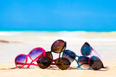 Picture many sunglasses lying on tropical beach Royalty Free Stock Photo