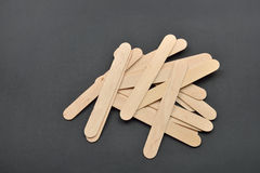 Picture of many wooden spatulas for wax depilation on black back Royalty Free Stock Photo
