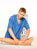 Picture of massage specialist doing his job Stock Images
