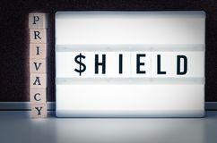 Blocks with inscription Privacy Shield to illustrate the EU USA Privacy Shield Agreement for the transfer of data from Europe to t. The picture means the privacy stock image