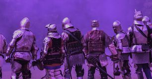 Medieval Knights set against an ultra violet background. A picture of a medieval knights set against an ultra violet background of early morning fog before the stock photos