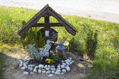 Picture of a memorial cross for accident victim. Picture of a memorial cross and angel figurine for accident victim Royalty Free Stock Photography