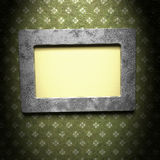 Picture metal frame with a decorative  pattern. Ornamented, silver metal empty picture frame for putting your pictures in Royalty Free Stock Photo