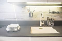 Picture of a modern white kitchen royalty free stock image