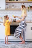 Picture of mother and daughter cooking in kitchen royalty free stock photography
