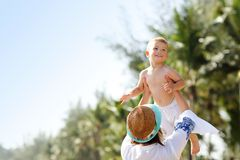 Mother having fun on the beach with her little son Royalty Free Stock Photos