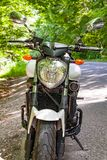 Motorcycle parked on the road Royalty Free Stock Images