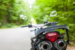 Motorcycle parked on the road Stock Photo