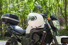 Motorcycle parked on the road Royalty Free Stock Photography