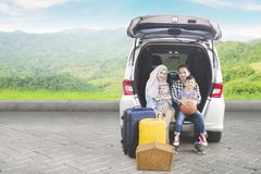 Muslim family with car at outdoor Stock Photography