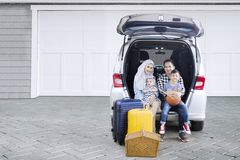 Muslim family with car in the house garage Stock Image