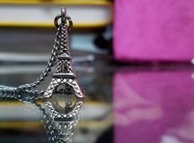 Eiffel Tower Necklace. A picture of a necklace of the Eiffel Tower. Relatively smaller compared to the real one in France, however, very close in resemblance Stock Image