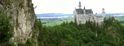 Picture of Neuscwanstein with a rock Royalty Free Stock Images