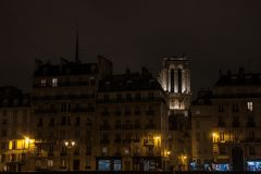 Notre Dame de Paris cathedral surrounded by medieval residential buildings typical from Ile de la Cite in Paris, France. Picture of Notre Dame de Paris cathedral Royalty Free Stock Photography
