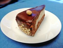Nougat cake with chocholate on white plate. Picture of nougat chocholate cake on white plate stock images