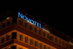 Novotel logo on their main hotel for Hungary during the evening. Novotel is a hotel chain of the Accorhotel group. Picture of a Novotel sign on their main hotel Stock Photo