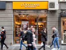 L`Occitane en Provence logo on their shop of Belgrade, people passing by. This brand is the most known Southern France Cosmetics. Picture of the Occitane en Stock Photos