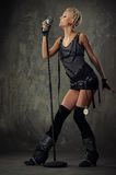 Picture Of An Attractive Steam Punk Singer. Stock Photos