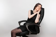 Picture Of Beautiful Woman In Black Dress Sitting In The Armchair Royalty Free Stock Image