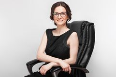 Picture Of Beautiful Woman In Black Dress Sitting On A Armchair Stock Photography