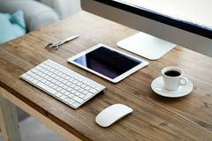 Picture of office desk with tablet computer and other accessories Royalty Free Stock Image