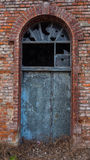Picture of old, destroyed door with broken window. Picture of old, destroyed door with broken window Royalty Free Stock Image