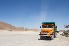 Old Iranian Dump Truck standing on a highway parking lot near Yazd, in the middle of the desert, on the road connecting most of th. Picture of an old iranian royalty free stock photo